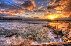 Bronte Beach (tobysaville) Tags: ocean morning sea sky sun beach pool clouds sunrise fence sydney australia nsw ripples swimmers rise hdr bronte beachscene oceanpool brontebeach oceanwaves goldenclouds oceansunrise hdrphoto beachatsunrise australiabrontebeach