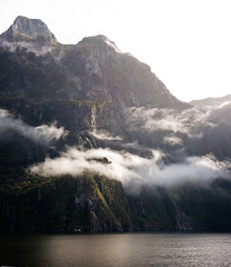 Milford Sound, Mist (OneEighteen) Tags: newzealand sky panorama mist mountains water vertical clouds reflections fjord milfordsound fiord fiordlands