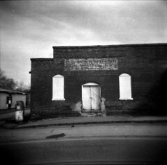 Small Town America (evanleavitt) Tags: life county camera wood brick 6x6 film sign analog rural america ga vintage way georgia toy town store holga doors decay south small ghost front gas pump nostalgic americana weathered medium format morgan vanishing 120mm 120n the darknes bostwick of