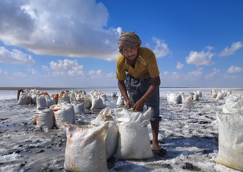 Pakistani worker in Barr Al Hikman salted lake - Oman