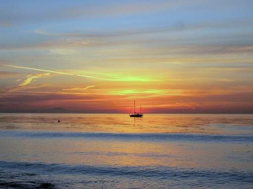 sun and sailboat