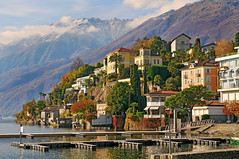 The nice Ascona (Tambako the Jaguar) Tags: trees houses mountain lake reflection buildings lago switzerland tessin ascona ticino nikon hill locarno maggiore d300