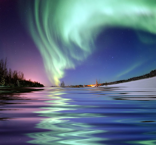 Aurora Borealis, the colored lights seen in the skies around the North
