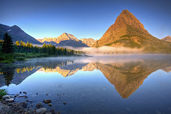 Grinnell Point Reflections (Matt Champlin) Tags: life morning travel mist reflection tourism nature misty fog sunrise landscape quiet peace glacier alpine swiftcurrent symettry swiftcurrentlake mtgould grinnellpoint sunriseswiftcurrentlake manyglacierscenery
