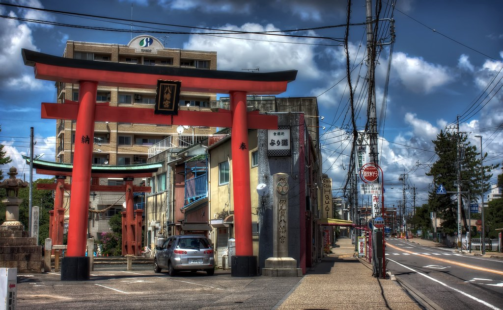 A giant torii gate in the middle of the road. Just a normal scene from Japan.