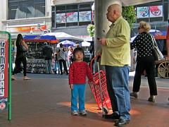 BostonRedCart (fotosqrrl) Tags: urban boston massachusetts grandfather streetphotography granddaughter macys cart downtowncrossing