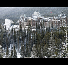 Chateau Banff Springs (robert_goulet) Tags: morning trees winter mountain snow canada cold nature digital forest river point hotel frozen frost ab frosty landmark olympus scene canadian alberta springs bow micro banff february chateau setting zuiko fairmont coniferous vantage ep1 2011 m43 zd mft fourthirds 1454mm mikecrough