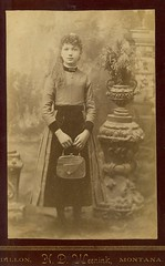 Girl with purse neatly posed at the  turn of century (Kingkongphoto & www.celebrity-photos.com) Tags: old city portrait art history love girl america vintage pose studio europe photographer image time antique unique rustic 19thcentury 1800s victorian human purse actress actor drama rare smalltown occupation longtimeago cabinetphoto