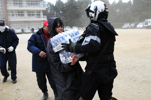 Sailor provides food and water to Japanese citizens during relief efforts.