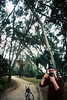 Morning Bike Rides (becca cahan) Tags: camera trees boy love film boyfriend bike tom analog 35mm canon focus florida ae1 bokeh canonae1 pictureofapicture 400iso bikerides palmcoast