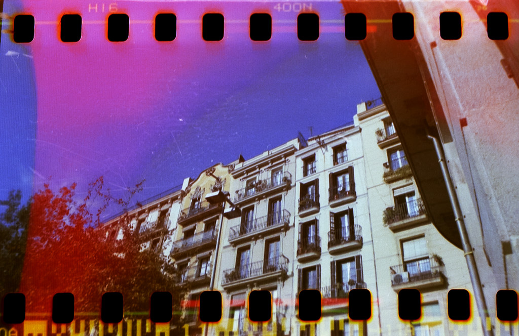 Home-scanned photo with sprocket holes of some random buildings in Barcelona.