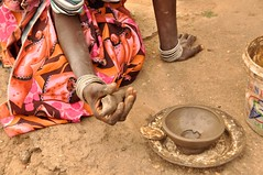 Kneading Clay (Lauren Barkume) Tags: africa red woman house black building rural circle southafrica design sticks pattern village handmade african traditional small large craft pot pots clay pile pottery ash ochre graphite artisan venda limpopo crafter supershot tsonga mashamba gettyimagesmeandafrica1