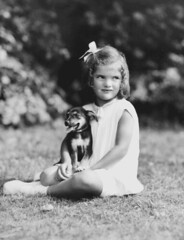 Photograph of Jacqueline Bouvier Kennedy at Age Four, ca. 1934 (The U.S. National Archives) Tags: portrait dog girl outdoors thirties 1930s child jacqueline ribbon seated kennedy 1934 bouvier firstlady nationalarchives jacquelinebouvier xmlns:foaf=httpxmlnscomfoaf01 nara:arcid=595973 foaf:depicts=httpnlagovaunlaparty1209583