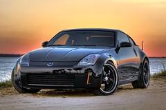 2005 Nissan 350Z HDR Sunset (1967 Firebird 400) Tags: sunset black color detail art beach water photography photo sand nissan florida orangesky coupe hdr highdynamicrange 350z sportscar postprocessing 2005nissan350z worldhdr