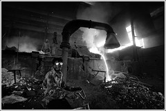 A bicycle ride through hell [..Narayanganj, Bangladesh..] (Catch the dream) Tags: boy bw mill industry glass monochrome look children fire blackwhite construction iron factory child smoke heat temperature fe spectacles bangladesh bnw hazard childlabour ironindustry ferric heavyindustry ferrous molteniron steelfactory steelindustry narayanganj rollingmill workingenvironment spectacularspectacles hazardousenvironment rerollingmill gettyimagesbangladeshq2