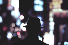 9 Days In Japan (Dylan-K) Tags: street man hat silhouette japan night dark movie person photography nikon alone colours bokeh candid suit osaka nikkor cinematic shinsaibashi 85mmf14 dylank