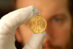 Ian Richardson holds a gold double eagle