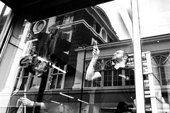 Reflections on window dressing (Paul J White) Tags: window reflections newcastle byker spnp lx5 beavans pauljwhite streetphotographynowproject arifasci lookforawindow