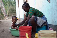 Having a bath (Zul Bhatia1) Tags: africa november people tanzania child zul washing arusha 2010 bhatia zulbhatiacopyright