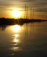 The Ribble at dusk (Tony Worrall Foto) Tags: uk sunset england copyright sun reflection wet water beauty sunshine electric season gold golden evening photo interesting northwest image dusk towers stock scenic picture lancashire wires use ripples outlines pylons uprights lancs portway wetreflection preson riverribble prestondocks ashtononribble prestonian tonyworrall 2011tonyworrall