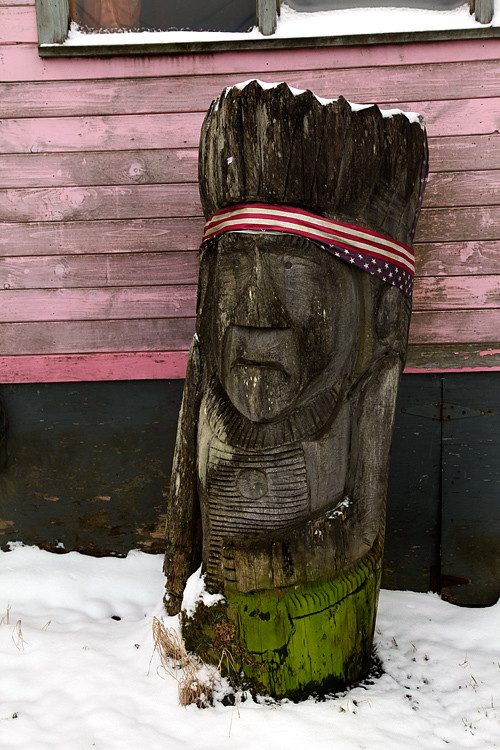 wood sculpture and snow, Craig, Alaska