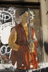 Poster (StartTheDay) Tags: street city nyc newyorkcity travel light urban usa holiday newyork man male art poster graffiti fighter geek manhattan sony culture billboard sword warrior states safe february dslr amateur hombre counterculture mec tunic 2011 sonyalpha a550 alpha500 sonydslr500