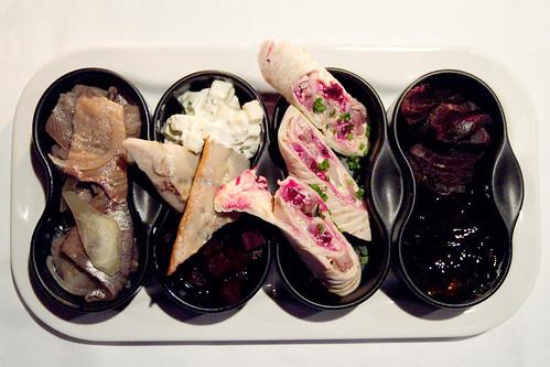 Pickled herring with apple, smoked herring, smokd elk wrap, deer