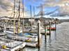 Docked at Morro Bay (Didenze) Tags: sky texture clouds boats harbor dock desaturated morrobay hdr selectivecolor canon450d hdrspotting didenze