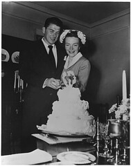 Photograph of Newlyweds Ronald Reagan and Nancy Reagan cutting their wedding cake, 03/04/1952 - 03/04/1952 (The U.S. National Archives) Tags: wedding cake ronald nancy reagan ronaldreagan 1952 nancyreagan presidentiallibraries nancydavis presidentreagan ronaldwilsonreagan usnationalarchives nara:arcid=198602