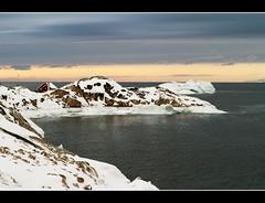House Behind The Rock (Kiddi Einars) Tags: ocean sea house snow rock greenland sjr snjr hs grnland haf klettar ilulissat grnland