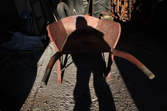 Newport, Nova Scotia (Avard Woolaver) Tags: light shadow sunlight selfportrait tractor canada colour brooklyn photography march photo spring flickr novascotia farm surrealism newport canondslr wheelbarrow digitalimage 2011 contemporarylandscape sociallandscape mar4 topf25faves canoneos60d avardwoolaverphoto leefriedlanderinspiredby