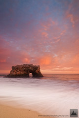 Bleeding Heaven - Natural Bridges State Park, California (david.richter) Tags: ocean california statepark pink sunset red summer orange usa santacruz seascape fall monument nature water northerncalifornia canon wonder landscape eos rebel gold twilight raw waves sundown pacific outdoor dusk hiking unitedstatesofamerica salmon hike adventure norcal polarizer rare circular graduated naturalbridges manfrotto kalifornien xsi rushing happydance giottos gnd goldencoast rainshowers singleexposure ishootraw top20colorpix nohdr davidrichter singhray 450d nofog aftersundown gradualneutraldensityfilter northofbigsur wwwdavidrichterphotographycom nomarinelayer