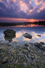 Treasure every moment that you have...live every moment as if it was your last. (tropicaLiving - Jessy Eykendorp) Tags: light sunset sea sky bali seascape beach nature water clouds canon reflections indonesia landscape rocks tide low shoreline burst filters hitech sunstar gnd efs1022mmf3545usm outdoorphotography canoneos50d seranganisland pulauserangan