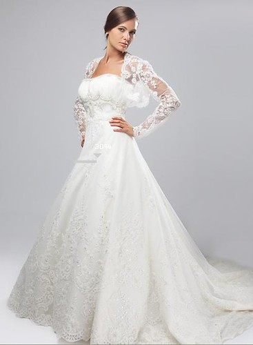 Ornate lace sleeves and a jacket for luxurious wedding dress