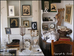 A closer look at my corner of curiosities (Boxwoodcottage) Tags: door old music baby white black flower bunny bird alarm clock home window glass colors leather silhouette rose urn vintage silver paper glasses march frames wire shoes hare doll candle faces nest market box head lace antique interior letters watch bisque seed rusty style books plaster shelf collection bust frogs eggs bible sheet chic flea tool styling holder quail vessels 2010 papaver transom botanicals ampersand pressed neutral shabby curisosities boxwoodcottage crewet