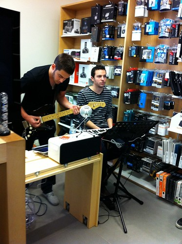 Musicians performing in the corner of the Apple store