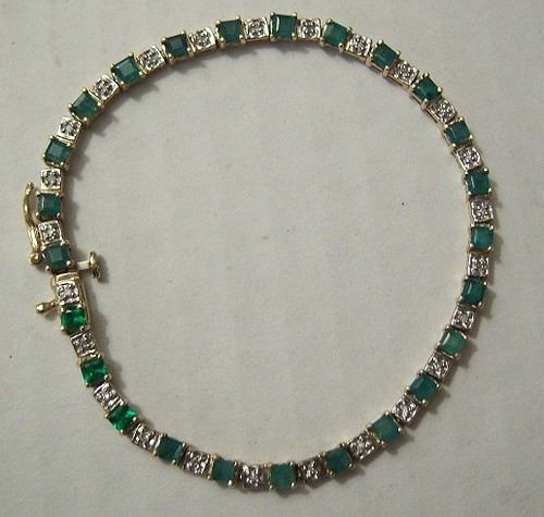 Gold Tennis Bracelet set with alternating table cut Emeralds and Diamonds (circa 1980's), closed view