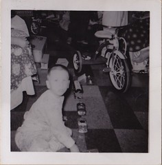 Uncle Kevin with Christmas Toys (Buttons McTavish) Tags: christmas york cars bike toys kevin bell pennsylvania uncle 1957 trike 1950 tricyle surprisedbycameraflash