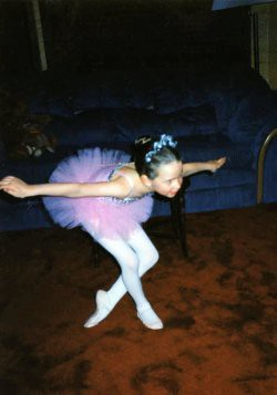 Christina (6) giving a repeat performance at home after her first ballet recital, 1996. Christina's love of dance led to her career as a professional ice dancer, choreographer, and Zumba instructor.