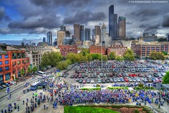 Seahawk Village (TIA International Photography) Tags: seattle city autumn people urban tower fall cars sports buses field skyline architecture tia person fan washington football downtown day pacific northwest audience distr