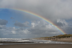 regenboog (jan-willem wolf) Tags: sea sky holland regenboog clouds strand coast nederland noordzee zee shore lucht zon noordholland kust zijpe petten janwillemwolf