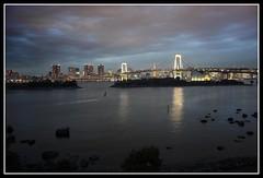 Rainbow in Tokyo (alexbaxterca) Tags: city colour night canon landscape tokyo brige rainbowbridge 450d odaibaisland lovelycity