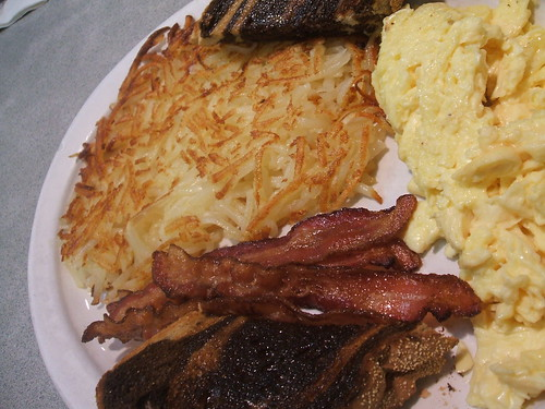 Hashbrowns, bacon, eggs, toast