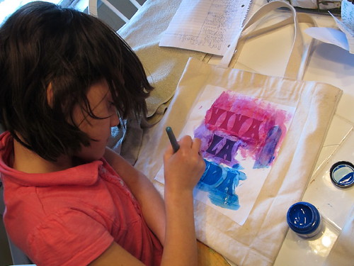 Stenciling the back of her Frida bag