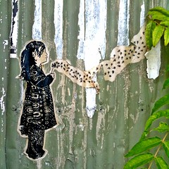 Dandelion Girl (Theen ...) Tags: bw green fence sticker iron peeling paint seed blowing dandelion seeds trail littlegirl puffy corrugated dilapidated puffball theen iphonee3gs