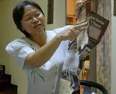 Ching Ching discussing the eco-baskets