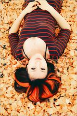 flaming. (Alli Jiang) Tags: autumn portrait orange fall girl leaves canon asian photography photo leaf orangehair gingko 2010 asiangirl fallenleaves lyingdown dyedhair hightlights chinesegirl stripeshirt t2i allijiang tinazhan