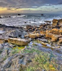 Breezy Laguna (Didenze) Tags: sky color clouds sunrise rocks pastel tidepools hdr lagunabeach canon450d vertorama hdrspotting didenze