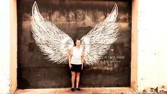 Showing off her wings (JeMaSiDi) Tags: delandwings oldwoman elderly angel wings deland centralflorida wallmural streetart city