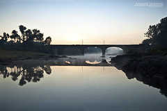 The Bridge (J Anand) Tags: morning bridge winter india water fog sunrise canon reflections village wideangle 1020 pune pp mws konkan thepca canon500d ruralindia slowwater vengurla photographerspune abeautifulmoment bhogave janand nivati anandjadhav wwwphotographersatpunecom malvn